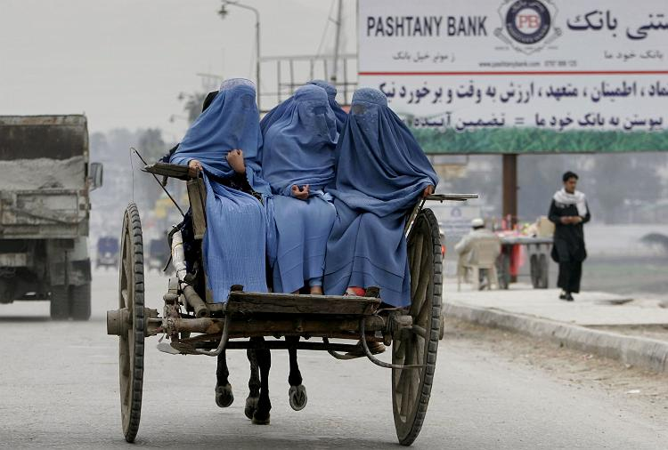 Afghan women are transported on a horse-drawn cart in the city of Jalalabad, the provincial capital of Ningarhar province, east of Kabul, Afghanistan, Tuesday, Feb. 3, 2009. (AP Photo/Rahmat Gul)